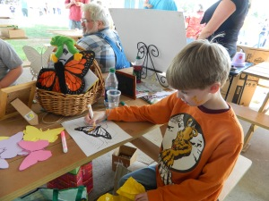 "Gideon Fegman coloring a page from ""Monarch Butterfly Coloring Book"" copyright Mary Ellen Ryall"